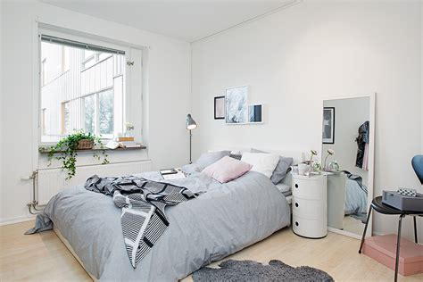 All White Bedroom by Bright And Cozy Apartment In Gothenburg Featuring Unique