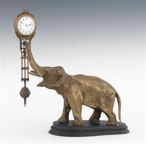 swinging clock an elephant swinging arm clock modern 09 06 12 sold 299