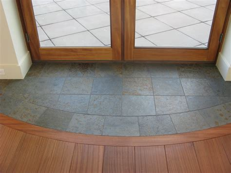 front door threshold transition  hardwood floor