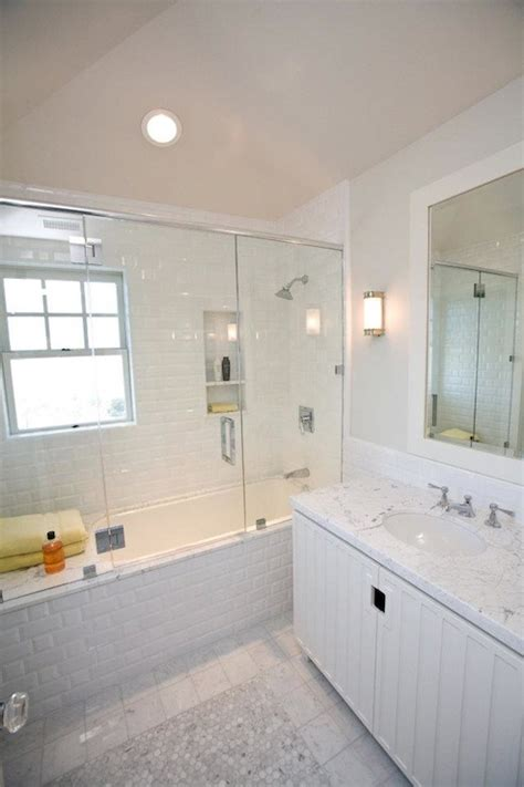 white bathroom subway tile subway tile shower transitional bathroom andrea may