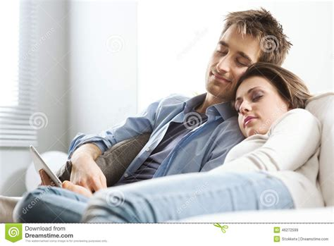 got a couple of couches sleep on the loveseat couple sleeping on sofa stock photo image 46272599