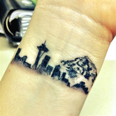 seattle skyline tattoo yep that may be the wrist tat i get of chicago skyline