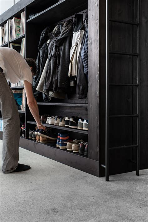 living in a walk in closet living cube combines entertainment center bookshelves