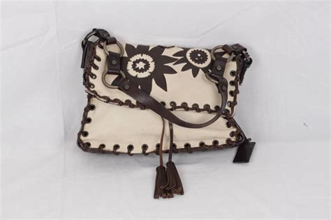 Dolce Gabbana Lavender And Ivory Purse by Dolce And Gabbana Ivory And Brown Leather Shoulder Bag