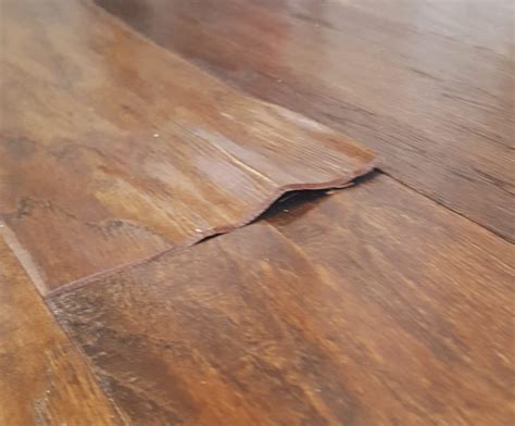 Hardwood Floor Water Damage Fixing The Flooring After The Flood How To Patch Damaged Wood Floors Loving Here