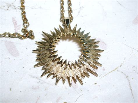 Outer New Tone 1 vintage coventry gold tone outer space sunburst pendant