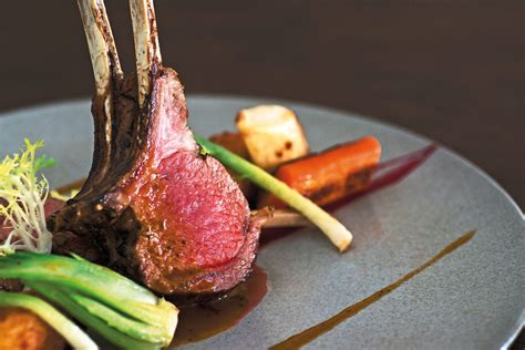 rack of lamb on grill balinese megibung meals launched at paon bali resto now