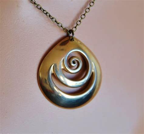 solid bronze domed koru pendant new zealand jewellery felt