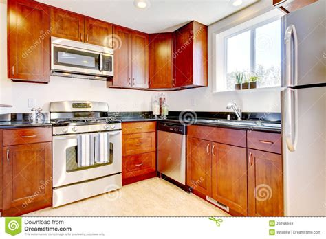 free kitchen appliances modern cherry kitchen with steal appliances royalty free
