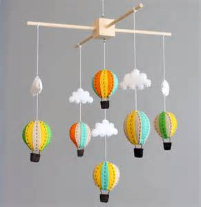 baby mobile green orange and yellow wooden air