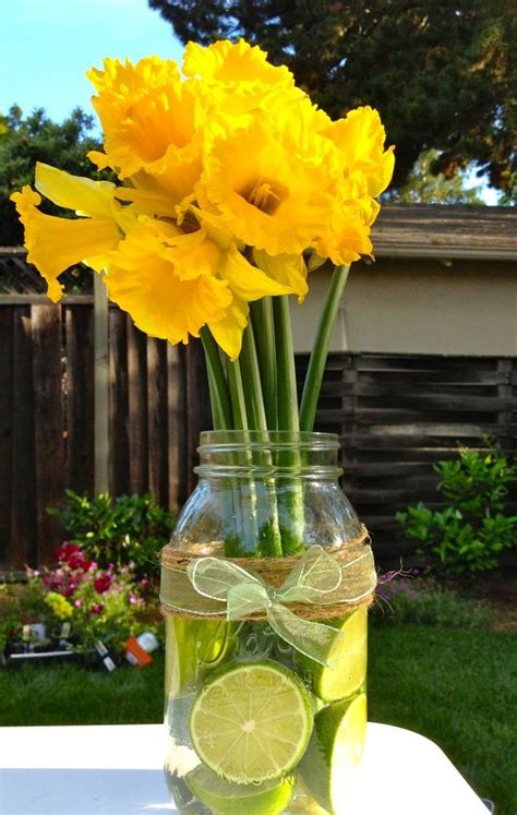 diy summer wedding citrus and daffodil centerpiece