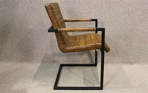 Tan leather armchair with steel frame. A wonderful leather