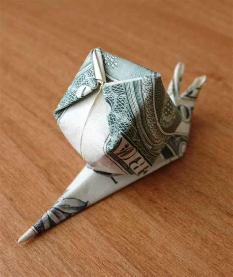 dollar bill origami dollar bill origami snail by craigfoldsfives on deviantart