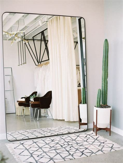 beautiful oversized mirror living room oversized wall mirror cute cactus and a moroccan rug