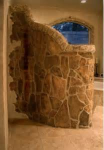 Walk in shower stone wall curved stone wall wraps around
