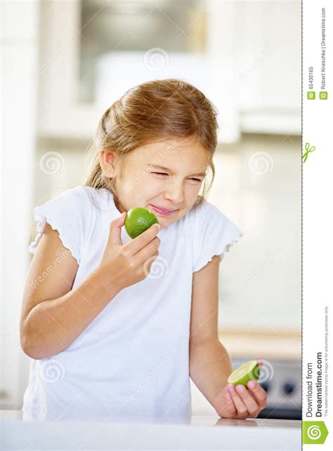 eats lime trying to eat lime fruit stock photo image 65430165