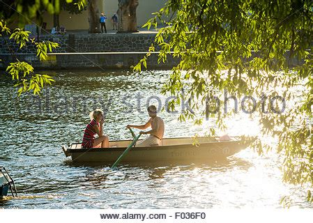 paddle boats on the vltava river people in paddle boats in vltava river smetana museum and