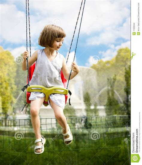 girl on swing little girl on a swing stock images image 11300044