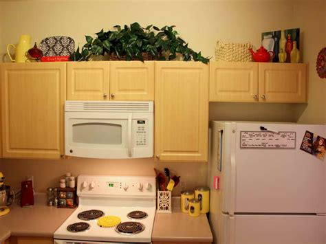 what to put on top of your kitchen cabinets beautiful what to put on top of kitchen cabinets what to