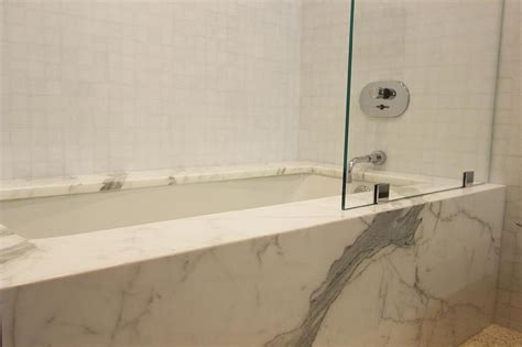 Grid Bathtub by White Grid Shower Tiles Statuary Marble Clad Tub With