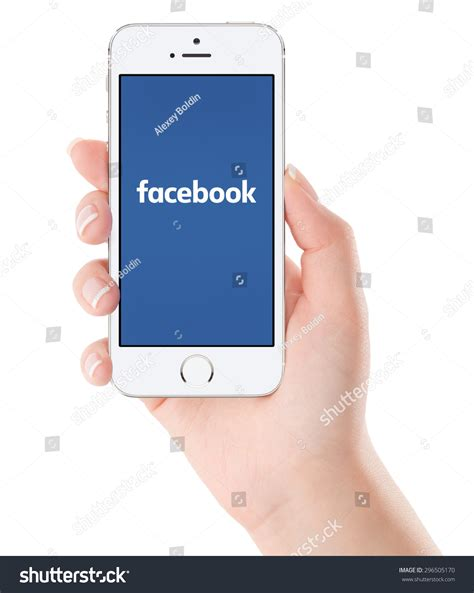 varna bulgaria february 02 2015 female hand holding white female hand holding apple silver iphone 5s with facebook