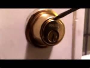 how to tighten door handles with screws kwikset