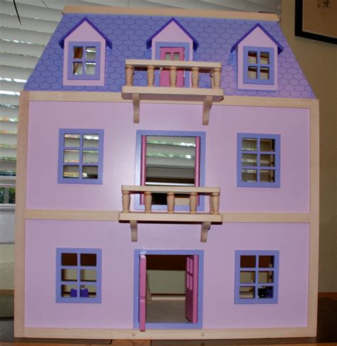 amazon doll houses amazon com melissa doug multi level solid wood dollhouse w family of 5 dolls