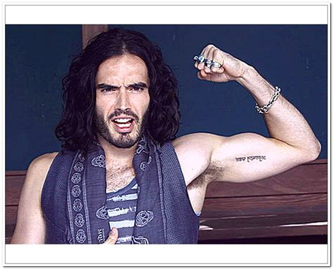 russell brand tattoos brand arm tattoos all these