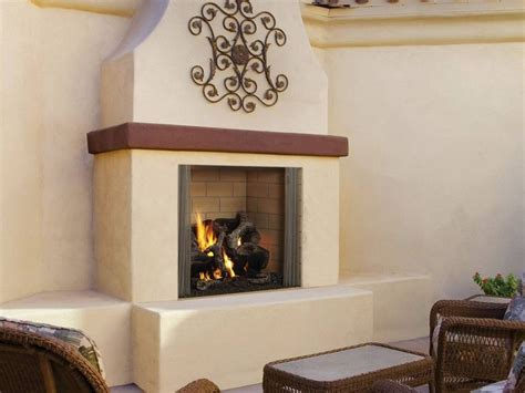 outdoor fireplace stucco surround with wood mantel