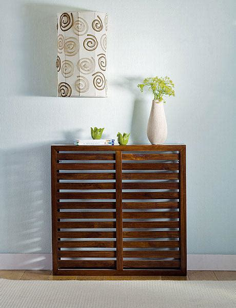 15 ideas to hide ugly radiators by making them looks like