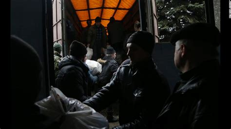 residents help unload humanitarian aid from a black hawk helicopter in why is there renewed tension in ukraine cnn