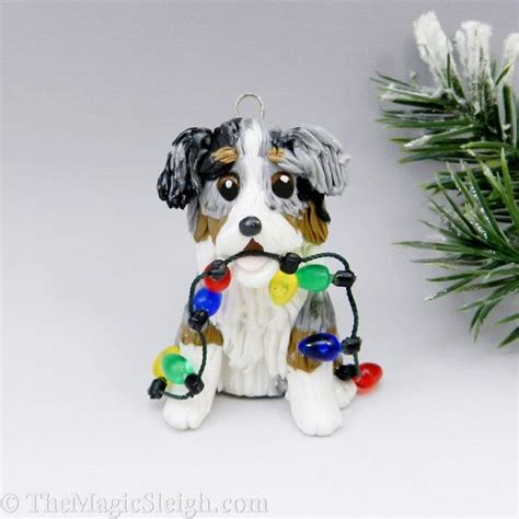 australian shepherd ornaments and christmas lights on