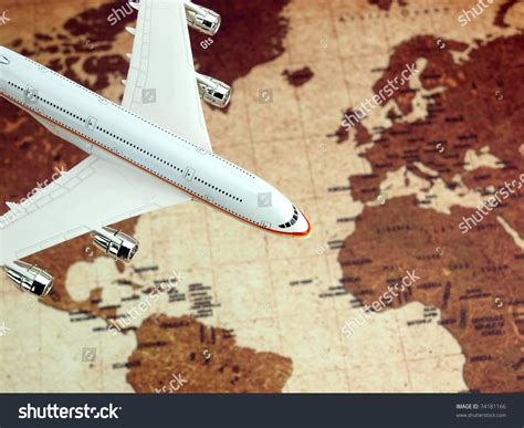Gts Circling White airplane flying the world map stock photo 74181166