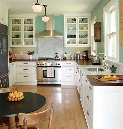 White Kitchen Cabinets With Butcher Block Countertops White Cabinets Aqua Walls And Wooden Butcher Block Countertops