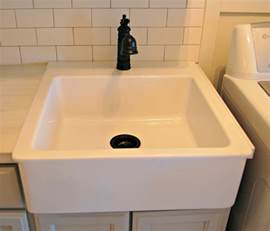 Shapely laundry room sinks in square shape design with black faucet