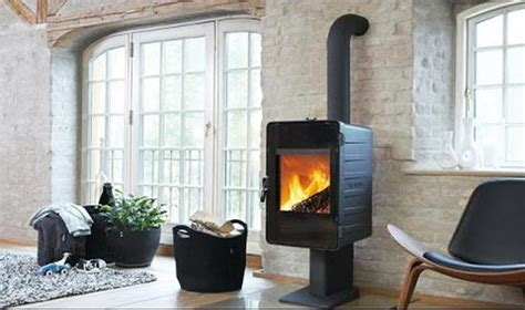 Wood Stove In Living Room by Wood Stoves And Inserts Offering Efficient Heating And Creating Cozy Seating Areas