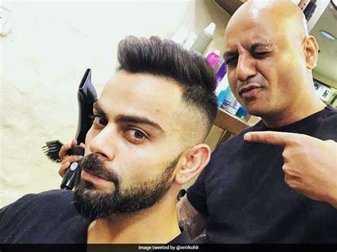 new hairstyle of virat kohli virat kohli flaunts his new hairstyle ahead of ipl 2018