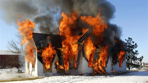 house burnt down completely reasonable man tries to kill spider burns down his house