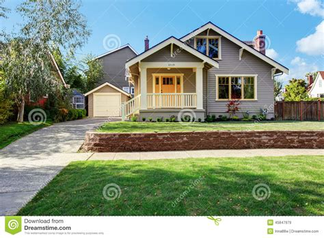 grey house grey house exterior with white porch and orange door stock photo image 45847979
