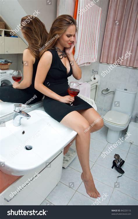drunk in bathroom attractive drunk woman her bathroom glass stock photo
