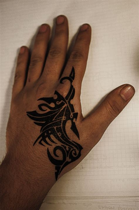 tattoo designs on hand for men awesome black tribal design for