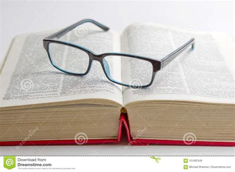 reading glasses placed on a book stock image image