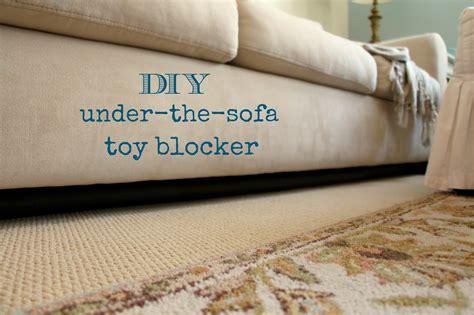 under the couch rachel s nest diy under the sofa toy blocker