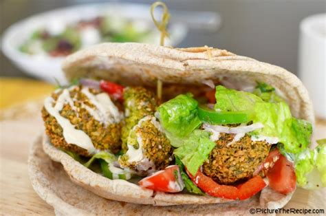 Pita Top Hq falafel pita with turkish salad and tahini sauce picture