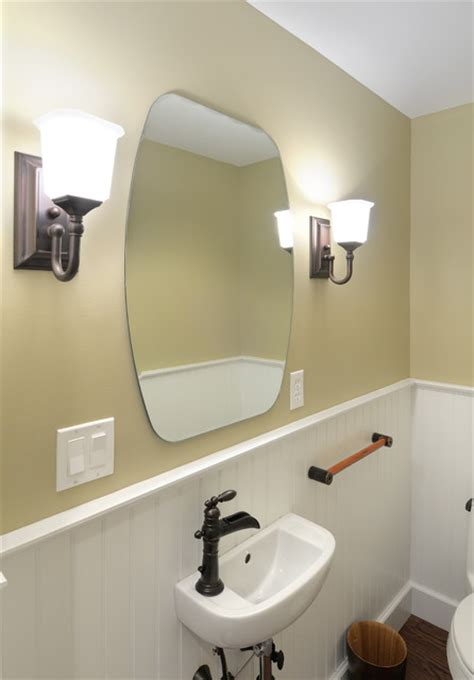 Traditional half bathroom remodel beadboard wall sconce traditional bathroom other metro