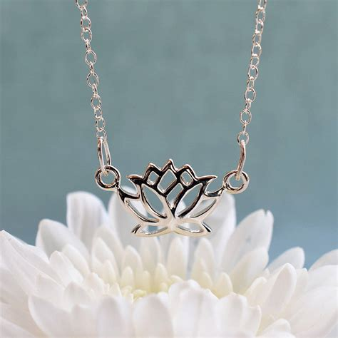 silver lotus flower necklace by charmed