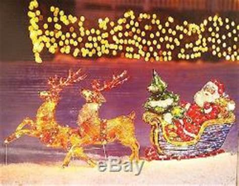 animated holographic santa light sculpture lighted santa sleigh reindeer outdoor holographic sculpture decoration