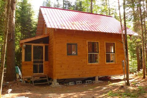 small cabin woods living simple grid house