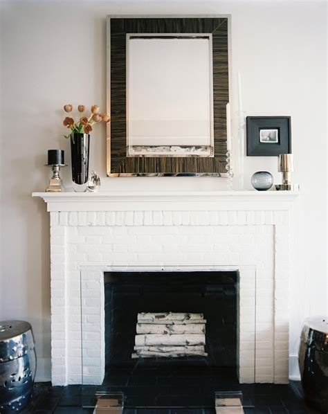 white painted brick fireplace mirror above fireplace contemporary living room