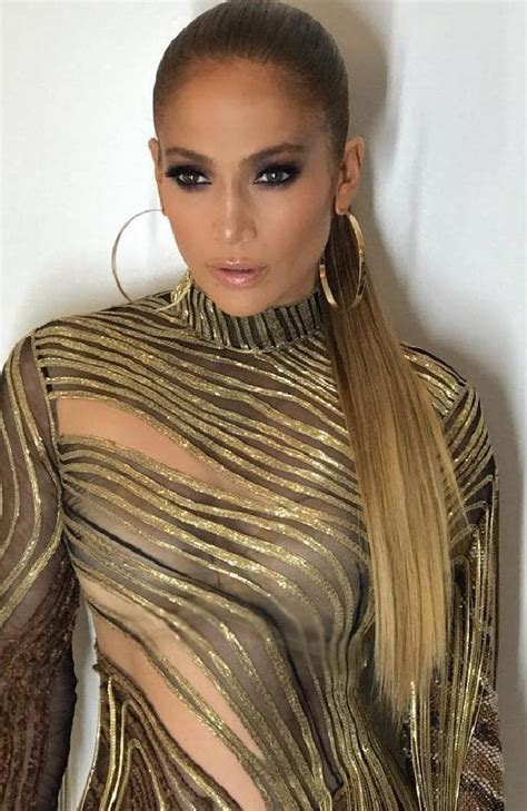 what type of foundation does j lo wear jennifer lopez stuns in plunging sheer cutaway dresses in